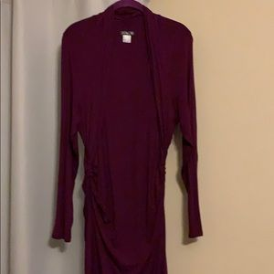 Burgundy dress, long sleeves, accents the waist